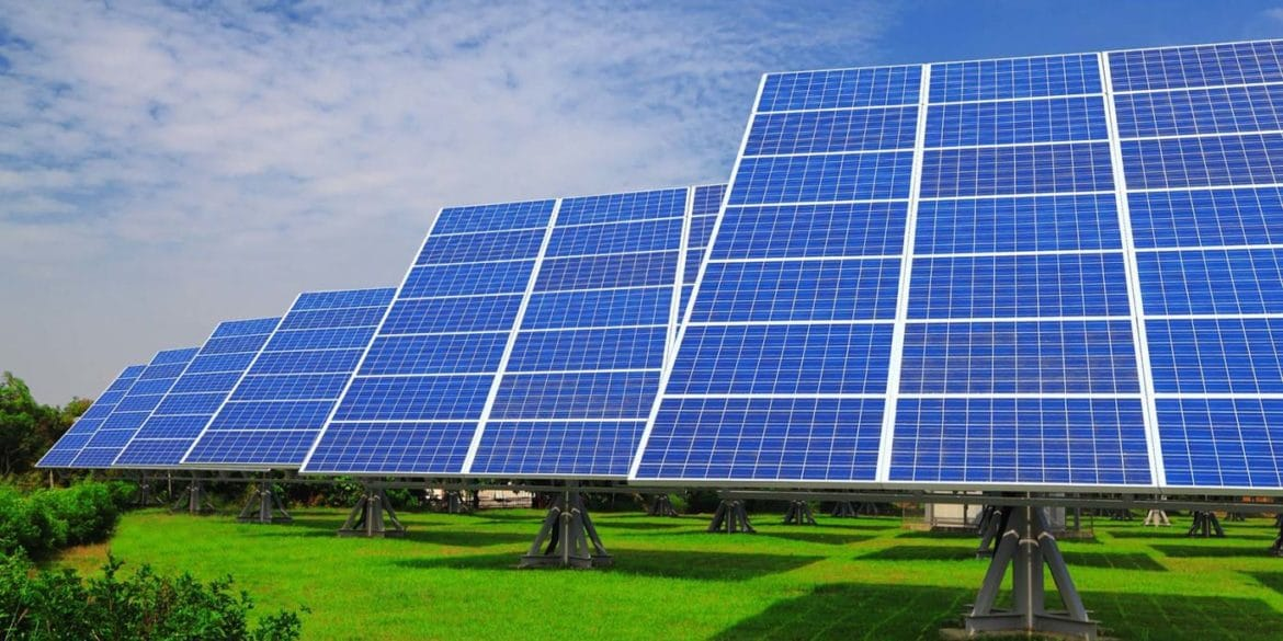 Solar Panel with green grass and beautiful blue sky
