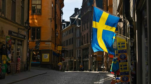 Swedish flags fly from a tourist souvenir shop in Gamla Stan in Stockholm, Sweden, on Thursday, March 26, 2020. Sweden is starting to look like a global outlier in its response to the coronavirus. Photographer: Mikael Sjoberg/Bloomberg